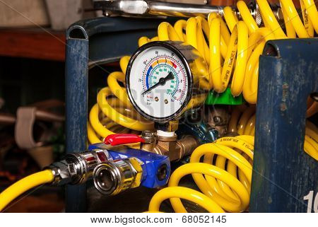 Pressure Gauge On Empty Air Tank With Spiral Air Tube