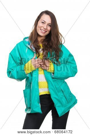 Young Woman Smiling With Green Raincoat