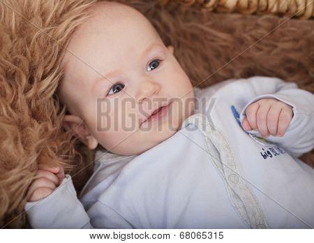 little cute baby boy  lying in basket