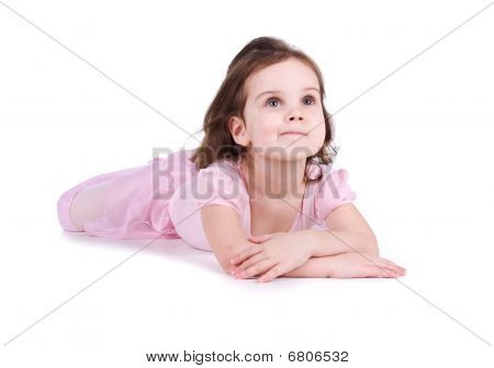 Cute Little Girl In A Pink Lie On The Floor
