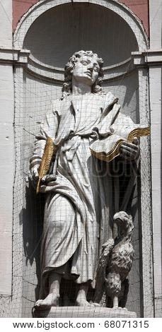 WURZBURG, GERMANY - JULY 18: St. John the Evangelist, Neumunster Collegiate Church, built in 1060 and completely renovated in the 17th century and since 1908 the parish church on July 18, 2013.