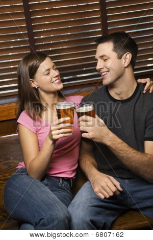 Couple Toasting Their Beers