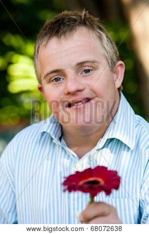 Handicapped Boy Giving Flower.