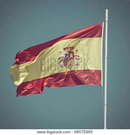 Flag of Spain blowing in the wind with blue sky