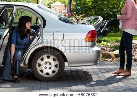Girl Taking Wheelchair From Car