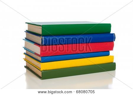 A stack of primary colored textbooks on a white background