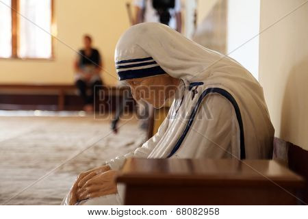 KOLKATA, INDIA - FEBRUARY 08: The statue of Mother Teresa in the chapel of the Mother House, Kolkata, India at February 08, 2014. The statue was made in the pose in which the Mother prayed.