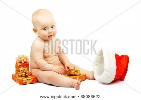 Cute baby with colorful christmas gift boxes