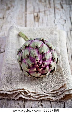 fresh artichoke on rustic wooden background