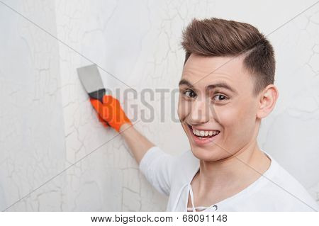 Young handsome man with spatula