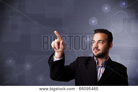 Handsome young businessman touching copy spase