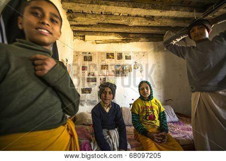 KATHMANDU, NEPAL - DEC 9, 2013: Unknown children after lesson at Jagadguru School. School established at 2013, to let new generation learn Sanskrit and preserve Hindu culture.