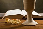 stock photo of chalice  - stil life with open bible and wine chalice - JPG
