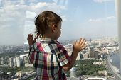 picture of penthouse  - The boy looking at Moscow from penthouse - JPG