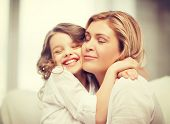 picture of pre-teen  - bright picture of hugging mother and daughter - JPG