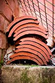 pic of red roof tile  - Small stack of red terracotta roofing tiles - JPG