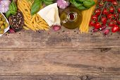 stock photo of pene  - Italian food ingredients on wooden background with copy space - JPG