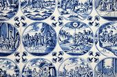 foto of biblical  - Close up of antique tin glazed blue Delft wall tiles dating from 1750 - JPG