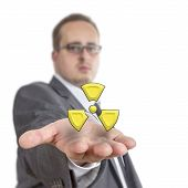pic of radioactive  - Business man reaches out his arm with a radioactive symbol floating over his hand. Isolated on White Background
