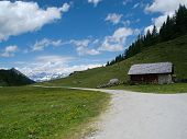 image of chalet  - View of the chalet with a road background with mountain peaks - JPG