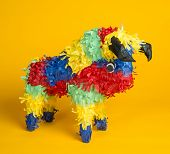 stock photo of pinata  - A mexican torro pinata  a yellow background - JPG