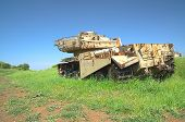 stock photo of emplacements  - HDR photo of destroyed rusty tank on battlefield emplacement - JPG