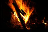 pic of ember  - Close up of a log fire with embers - JPG