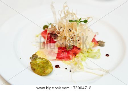 Fish appetizer in plate, close-up