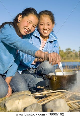 Beautiful Mongolian girls anjoy camping.