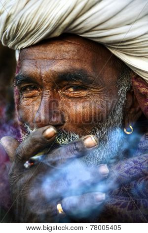 Indigenous Indian man smoking happily.