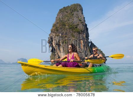 Young couple sea kayaking.