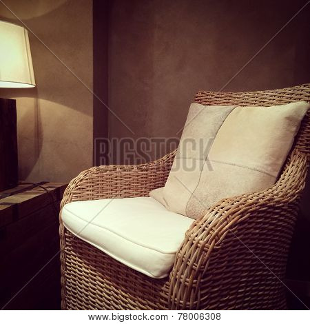 Classic Rattan Armchair And Cozy Lamp