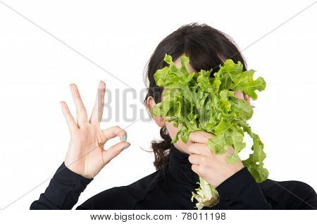 closeup portrait young girl holding fresh lettuce leaves in front of her face