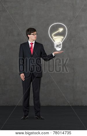 Businessman Holding Drawing Lightbulb