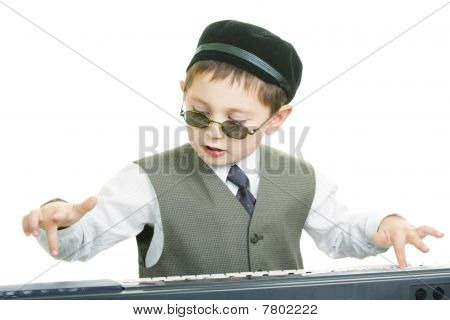 Cute Kid In Sunglasses Playing Piano