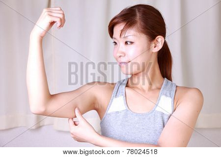 woman doing self arm massage