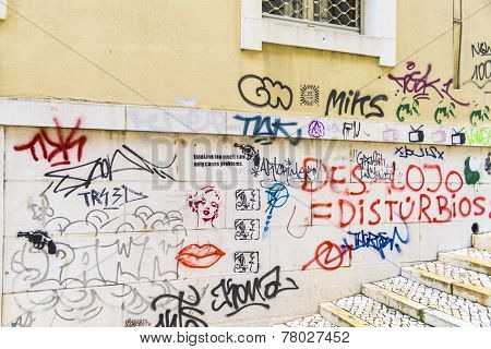 Facade In Old Town With Graffiti In Lisbon