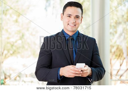 Hispanic Businessman Texting