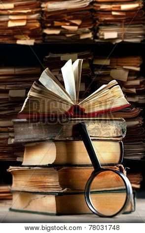 Old Books With Magnifying Glass