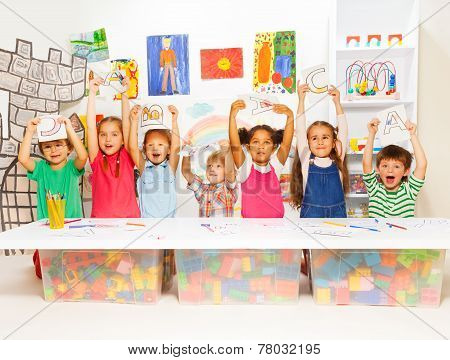 Group of little kids in early development lesson