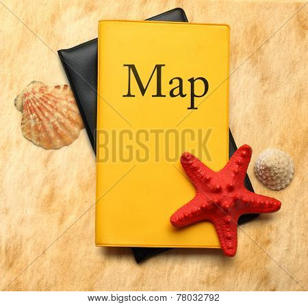 Seastar And Seashells With Map On Stained Paper