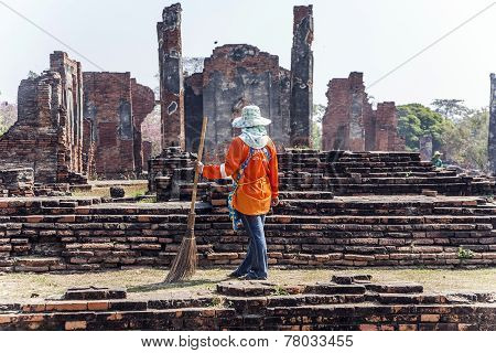 Worker At Temple Area In Ayutthaya Climbing A Stupa