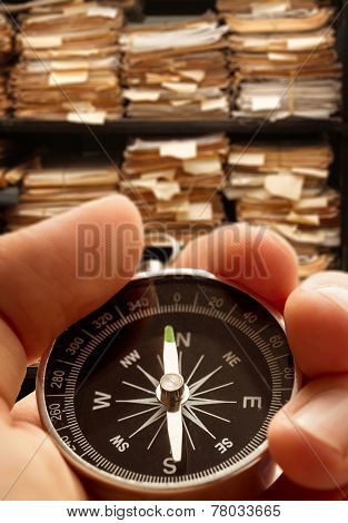 Hand With Compass On Paper Documents