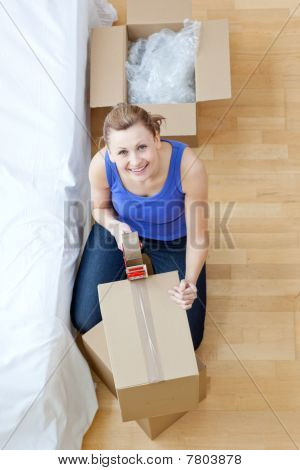 Smiling Woman Closing A Box