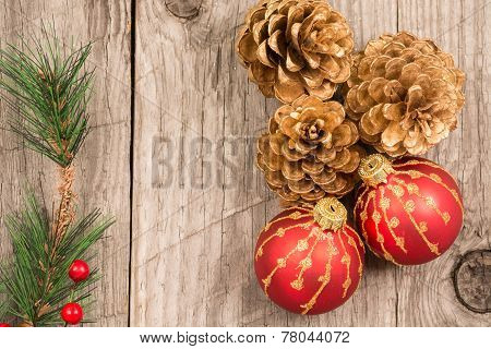 Christmas Baubles And Golden Pine Cones