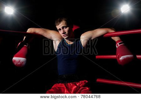 Man Sits In The Corner Of The Ring