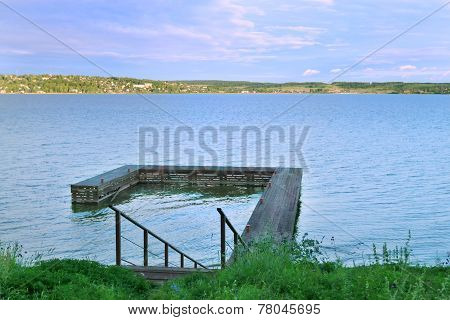 Stairs Down To Wooden Pier At Great River Kama In Evening Summer