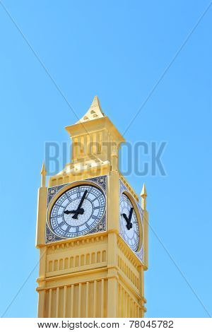 Yellow Layout Of Big Ben Tower On Blue Sky Background On Sunny Day