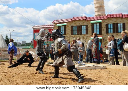 Perm, Russia - June 25, 2014: Two Swordsman Fighting With Swords On Sand At Festival White Nights