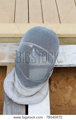 Grey Mask For Fencing Made Of Steel Wire On Wooden Boards And Sand Closeup
